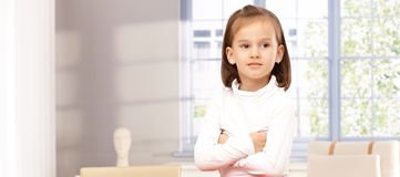 Cute little girl arms crossed Stock Images