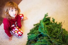Cute little girl assembling christmas tree. Royalty Free Stock Image