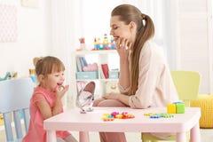 Free Cute Little Girl At Speech Therapist Stock Image - 105428811