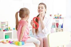 Free Cute Little Girl At Speech Therapist Stock Image - 105429101