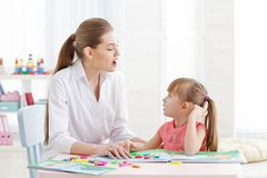 Free Cute Little Girl At Speech Therapist Royalty Free Stock Image - 105429246