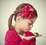 Cute Little Princess kissing a frog Royalty Free Stock Photos