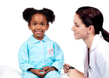 Cute little girl attending medical check-up Royalty Free Stock Image
