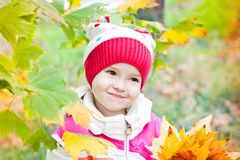 Cute little girl in autumn forest Royalty Free Stock Photo