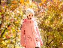 Little girl in an autumn forest Stock Photo