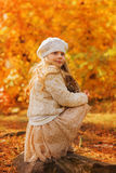 Cute little girl in autumn park Royalty Free Stock Photo
