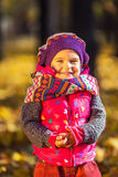 Cute little girl in the autumn park Stock Photos