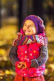 Cute little girl in the autumn park Stock Photo