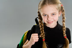 Cute little girl with backpack Royalty Free Stock Photo