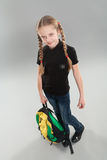 Cute little girl with backpack Royalty Free Stock Images