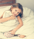 Cute little girl in a bad Stock Photography