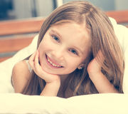 Cute little girl in a bad Royalty Free Stock Images