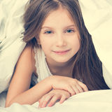 Cute little girl in a bad Royalty Free Stock Image