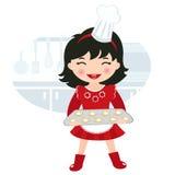 Cute little girl baking cookies Stock Image