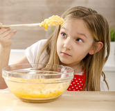 Cute little girl baking  and cooking Royalty Free Stock Images
