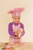 Cute little girl baking. Royalty Free Stock Photography