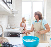 Cute little girl baking with her grandmother Stock Photography