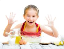 Cute little girl baking on kitchen Stock Images