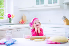 Cute little girl baking a pie Royalty Free Stock Image