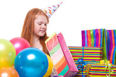 Cute little  girl with balloons and gift box Stock Photos