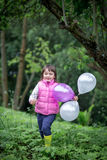 Cute little girl with balloons Royalty Free Stock Image
