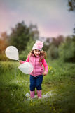 Cute little girl with balloons Royalty Free Stock Images