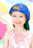 Funny girl in a cap Stock Photos