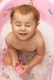 Cute little girl bathes in a shower Stock Photography