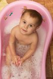 Cute little girl bathes in a shower Stock Photo