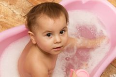 Cute little girl bathes in a shower Royalty Free Stock Photo