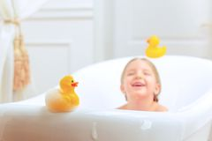 Cute little girl in the bathroom Stock Images