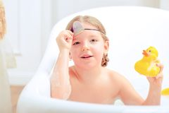Cute little girl in the bathroom Royalty Free Stock Image