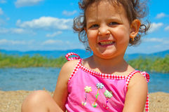 Cute little girl on the beach. With Hollywood smile Stock Photos