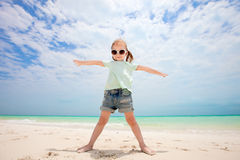 Cute little girl at beach. Portrait of cute little girl at tropical beach made with wide angle lens Stock Photo
