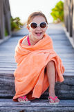 Cute little girl at beach. Covered with towel Stock Photography