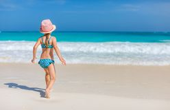 Cute little girl at beach. Portrait of cute little girl at tropical beach Royalty Free Stock Images
