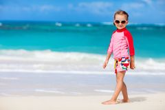 Cute little girl at beach. Portrait of cute little girl at tropical beach royalty free stock photos