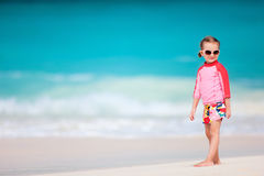 Cute little girl at beach. Portrait of cute little girl at tropical beach Stock Images