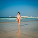Cute little girl on the beach Royalty Free Stock Photos