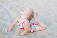 Cute little girl on the beach. Stretch Stock Photo