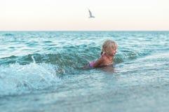 Cute little girl on the beach Stock Image