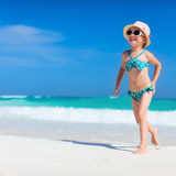 Cute little girl at beach. Cute little girl at tropical beach during summer vacation Stock Images