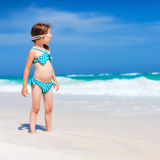 Cute little girl at beach. Cute little girl at tropical beach during summer vacation Stock Photo
