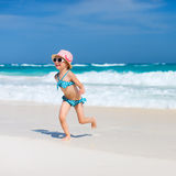 Cute little girl at beach. Cute little girl at tropical beach during summer vacation Royalty Free Stock Photos