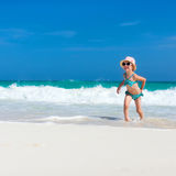 Cute little girl at beach. Cute little girl at tropical beach during summer vacation Stock Photography