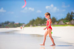 Cute little girl at beach during tropical vacation. Adorable little girl at beach during tropical vacation Stock Photo