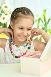 Cute Little girl with beads Stock Photos