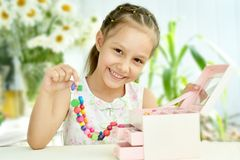 Cute Little girl with beads Royalty Free Stock Image
