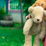 Cute little girl with a bear Royalty Free Stock Photo