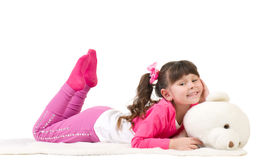 Cute little girl with bear Stock Image
